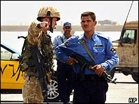 British soldier and Iraqi policeman in Basra