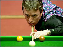 Ken Doherty lines up a long pot