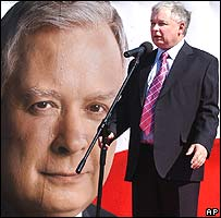 Jaroslaw Kaczynski speaks in front of poster of his twin brother Lech Kaczynski