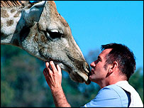 Giraffe and BBC presenter Nigel Marvan
