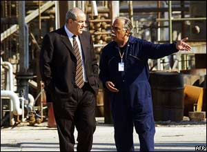 Iraqi Interim Prime Minister Iyad Allawi (left) visits the repaired part of an oil refinery in the Dura district of Baghdad, Iraq