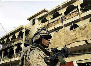 A US marine patrols the Sunni city of Falluja, Iraq