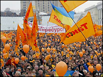 People hold orange flags and balloons during demonstrations in Kiev in 2004