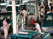 Drivers filling up at a petrol station in China