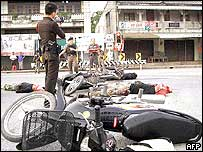 Police surveying bodies of attackers in Yala, April 28 2004