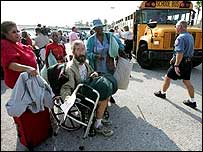 Galveston residents queue for buses