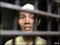 Syaiful Bahri looks out of his cell prior to the start of his trial at a court in Jakarta, 22 September 2005.