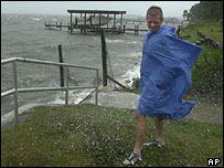 A boy braces himself against the wind at Fort Walton Beach, Florida