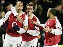 Thierry Henry (left) celebrates his first-half goal against Crystal Palace