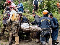Rescuers carry the body of one of the victims of floods in Merida, Venezuela