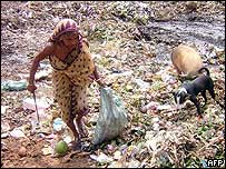 Indian woman scours a waste mountain for valuables