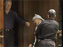 Clinton, Barak and Arafat share a joke at Camp David July 11, 2000