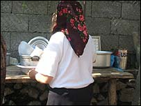 Woman washing up in garden