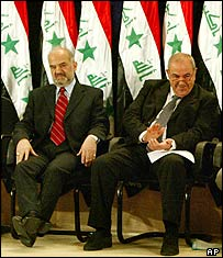 Ibrahim Jaafari sitting beside Iyad Allawi at their swearing-in ceremony last June
