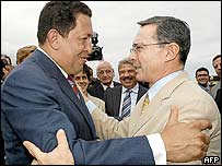Venezuelan President Hugo Chavez (left) greets his Colombian counterpart, Alvaro Uribe, at the Caracas airport