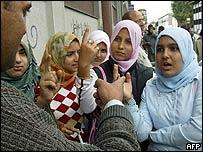 Pupils attend class outside Muslim school in Milan