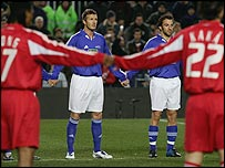 The world's finest footballers link hands for a minute's silence for victims of the Asian tsunami