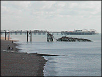 The collapsed West Pier with the successful Palace Pier in the distance