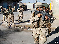 US and Iraqi soldiers patrol