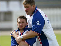England's Steve Harmison gets a stretch with then England physio Dean Conway