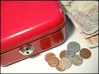 Coins, notes and a money box