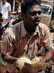 Baby's father buying coconuts