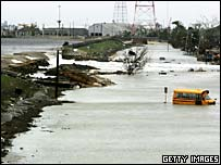 Floodwater pours over damaged flood defences in New Orleans. File photo