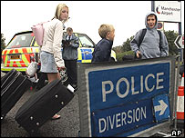 Passengers outside Manchester Airport