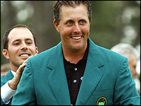 Phil Mickelson receives the famous green jacket last year