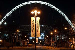 The arch at the site of the new Wembley Stadium was lit up ahead of the big visit