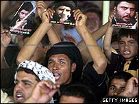 Supporters of militant Shia leader Moqtada Sadr at Friday prayers service