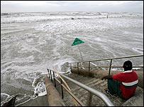 Man watches churning sea at Galveston, Texas