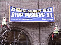 Greenpeace protesters unfurl a banner at the International Petroleum Exchange