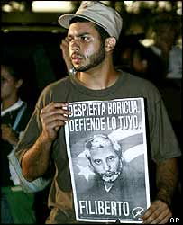 Protester carrying a poster of Filiberto Ojeda Rios at a demonstration in San Juan on Friday