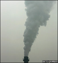 Smoke belches from a chimney in heavy fog on December 14, 2004 in Beijing, China.