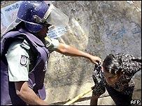 Policeman arrests a protestor