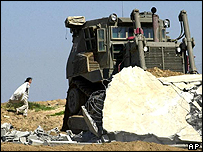 Israeli bulldozer demolishing home in Gaza