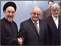 Iranian President Mohammad Khatami, left shakes hands with Syrian Prime Minister Mohammed Naji al-Otari, as Iran's Vice-President, Mohammad Reza Aref, stands at right