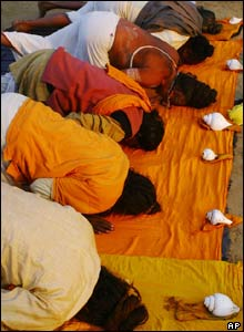 Hindu holy men perform morning prayers at the confluence of rivers Ganges and Yamuna.