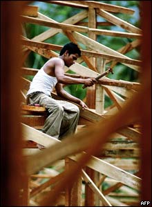 An Indonesian man works on the construction site of a relocation project in Banda Aceh.