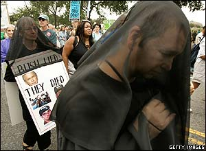 Protesters wear black veils on the march toward the White House on Pennsylvania Avenue