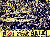 Borussia Dortmund fans protest against the sale of their near bankrupt club
