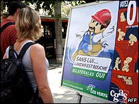 People look at a poster backing a 'Yes' vote in the Swiss referendum on EU labour rules