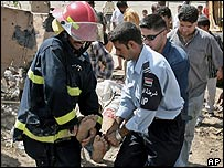 Iraqis carry the body of a civilian killed in a car bombing in Baghdad, Sunday 25 September 2005