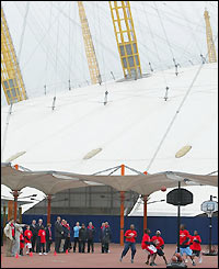 The huge structure of the Millennium Dome looms large over the inspectors