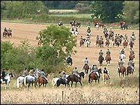 Followers on horseback follow the huntsman
