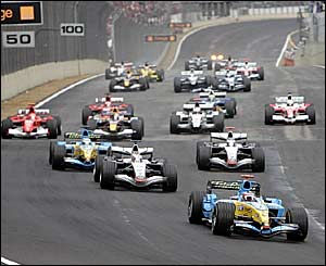 Fernando Alonso leads into the first corner
