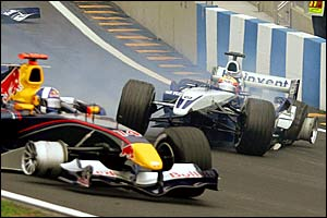 David Coulthard (left) and Antonio Pizzonia crash out before turn one