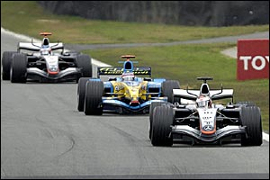 Juan Pablo Montoya (right) leads Fernando Alonso and Kimi Raikkonen