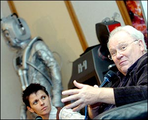 Colin Baker, with K9 and a Cyberman
